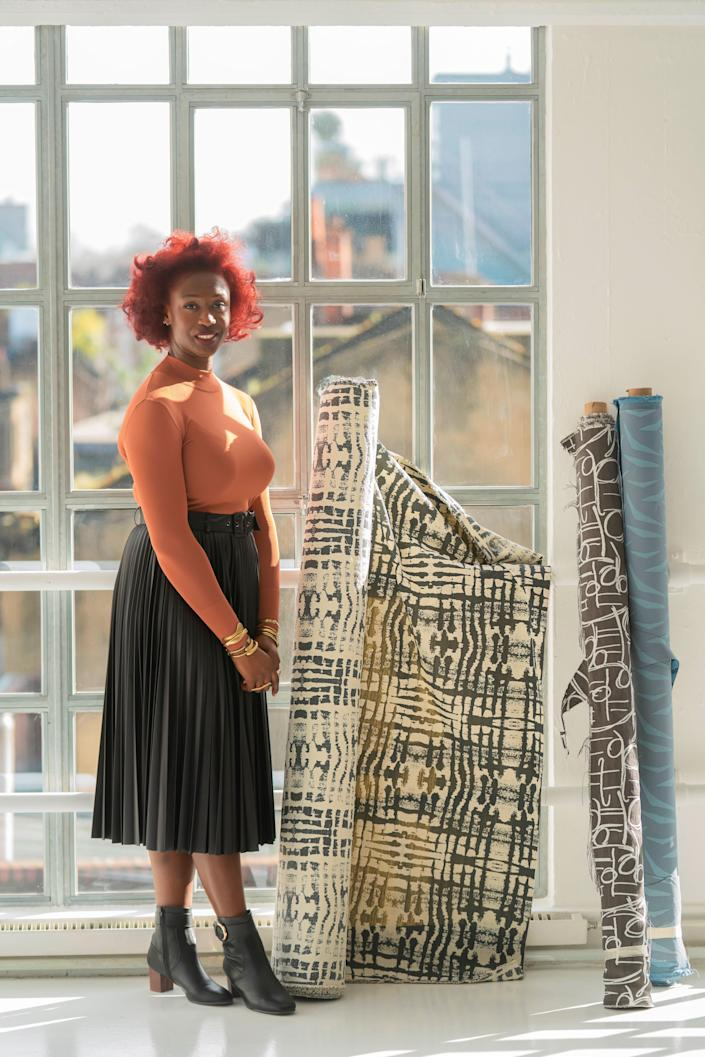 Chrissa Amuah with fabrics for Bernhardt Textiles.