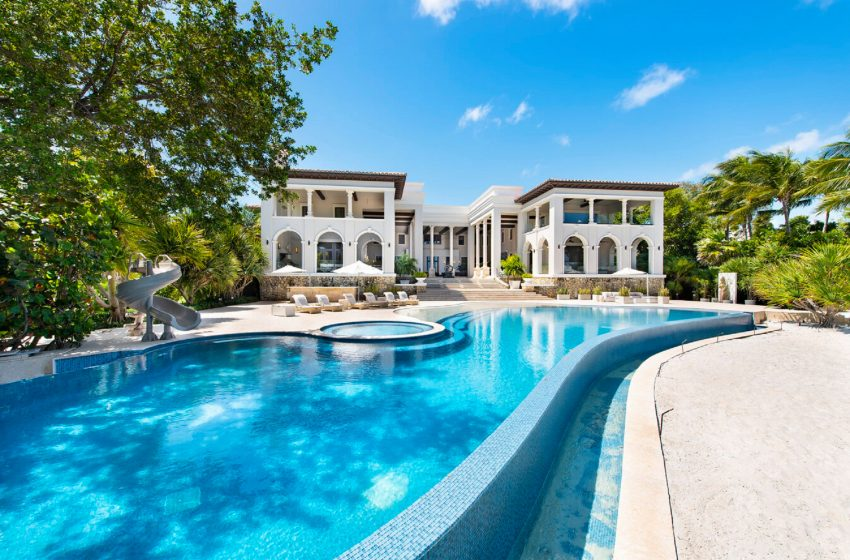 Banker and Carlyle 'advisor' wife land $30M Miami manse
