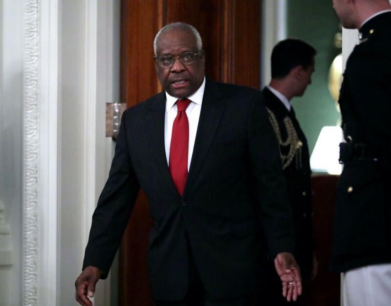 Supreme Court Justice Clarence Thomas walking through the White House.
