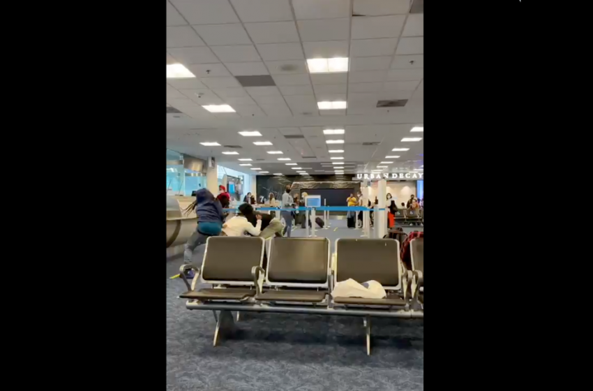 Large fight breaks out at Miami International Airport. One arrest made
