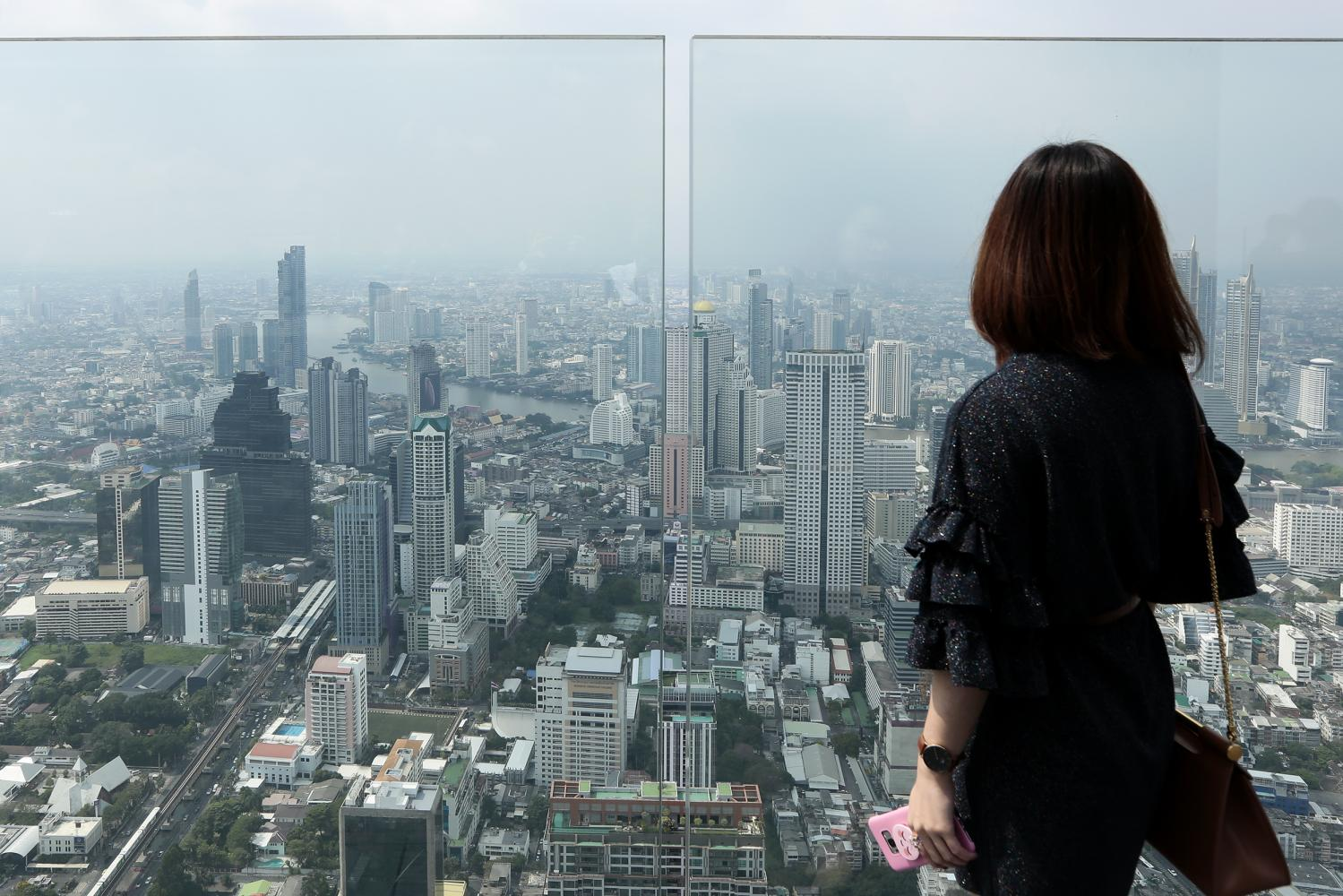 A view of high-rise buildings in Bangkok from Mahanakhon Skywalk, one of Thailand's tallest buildings. With affordable living costs, easy transport and warm weather, a website says Bangkok fits nomadic lifestyles.Patipat Janthong