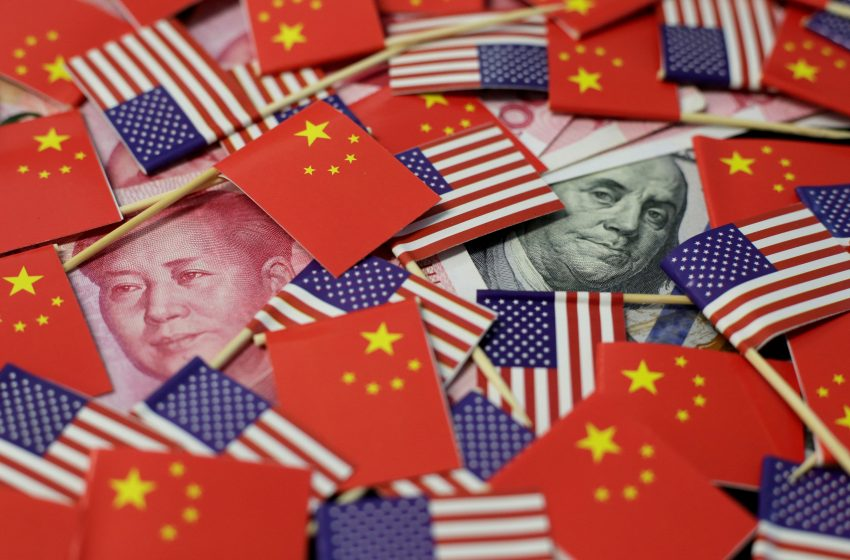 China sets yuan rmb weaker vs U.S. dollar for first time in a week