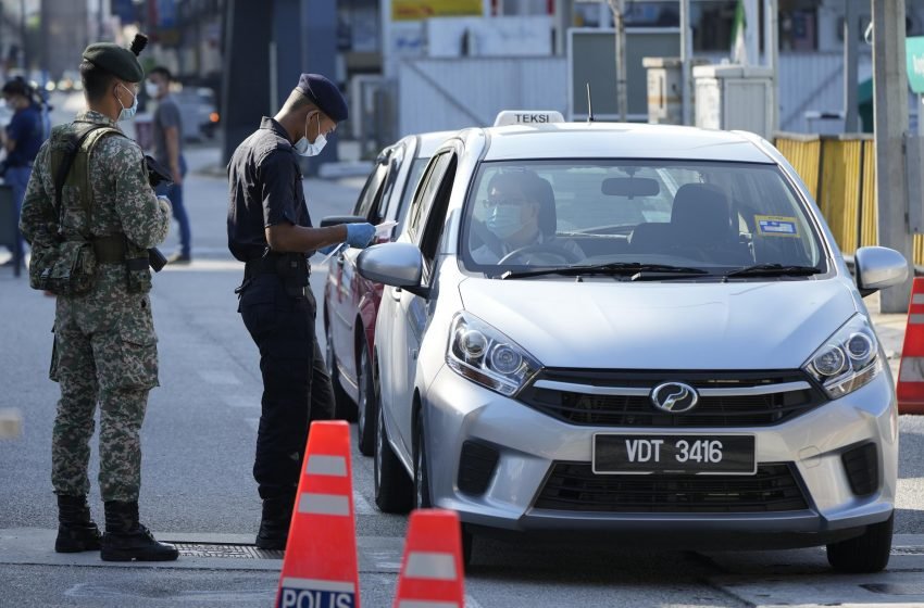 Businesses shut as Malaysia enters second virus lockdown – Associated Press