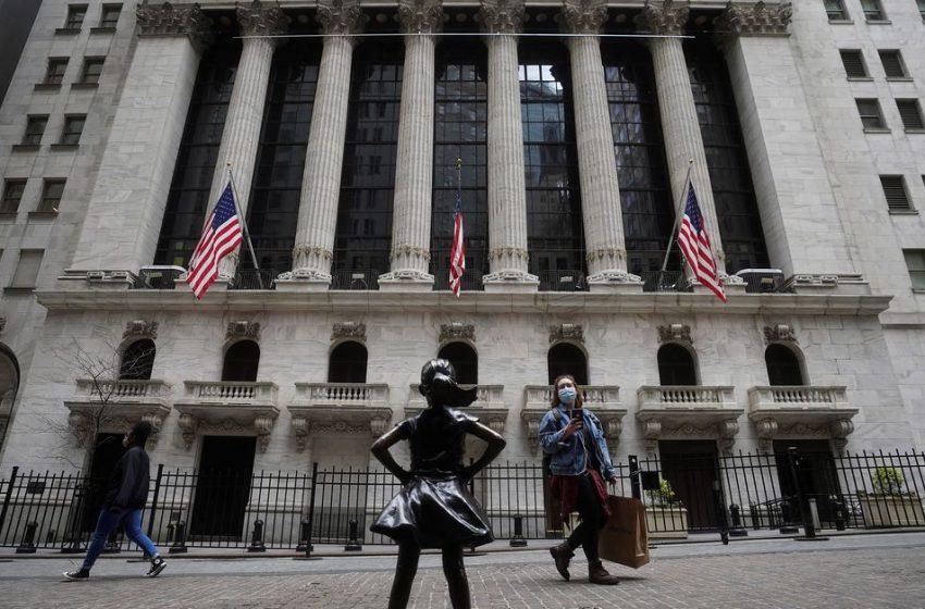 Tech surge lifts Nasdaq, S&P 500 to record high