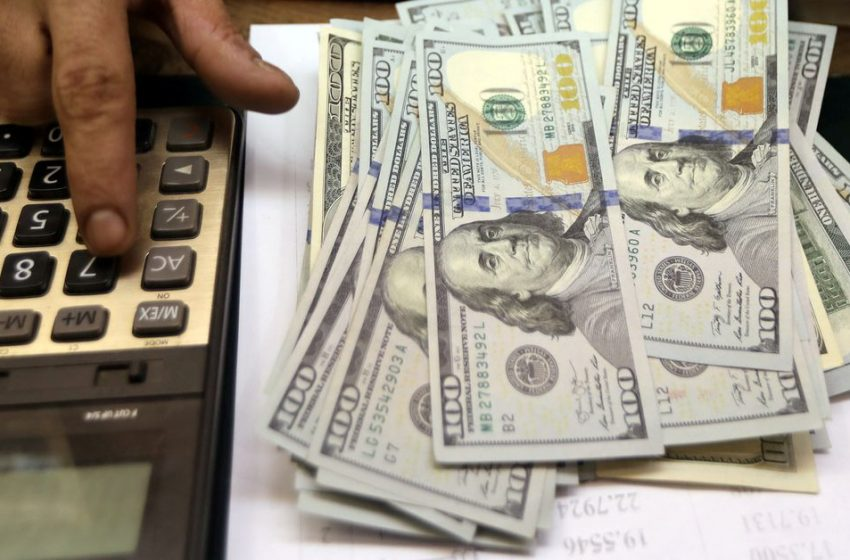Dollar retreats from highs as focus turns to payrolls